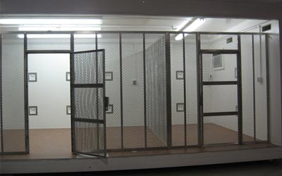 Cage walls segment an Arms Vault portable armory