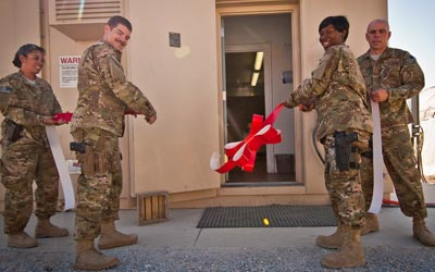 Military personnel celebrate the installation of an Armag Arms Vault / Armory