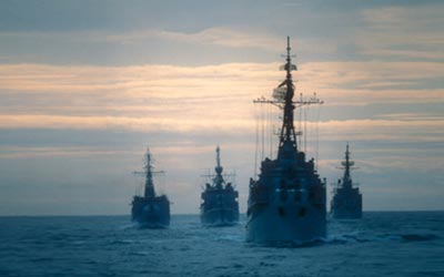 US Navy ships at sunset