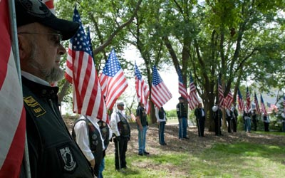 Veterans holding flags.